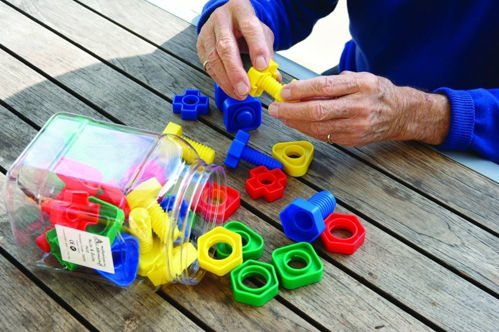 Nuts and Bolts set, 32 chunky plastic pieces to screw and unscrew, 4 shapes in 4 assorted bright colours,size:   Approx. (l) 6cm. 32 pieces. Handy storage tub.