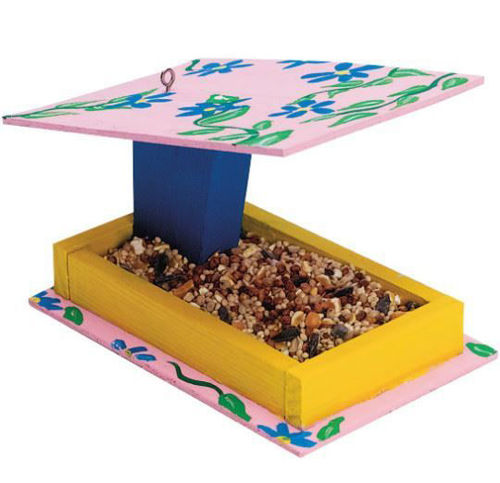 """<img src = """"Wooden Bird Feeder Craft Kit (Makes 12), colouful ready made wooden bird feeder oblong yellow tray with blue post holding pink flowered flat roof and eyelet to hang, size 15cm x 15cm x 10cm"""">"""