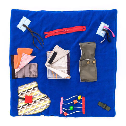 Blue activity blanket with 9 attachments for people with dememtia