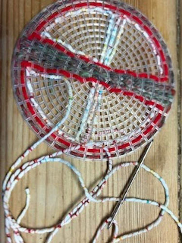 "<img src = ""Weave a Coaster, pack of four plastic mesh circles with holes, needles and yarn, image shows one mesh circle ready sewn with contrasting red and grey yarn and needle, size  11.5 cm dia"">"