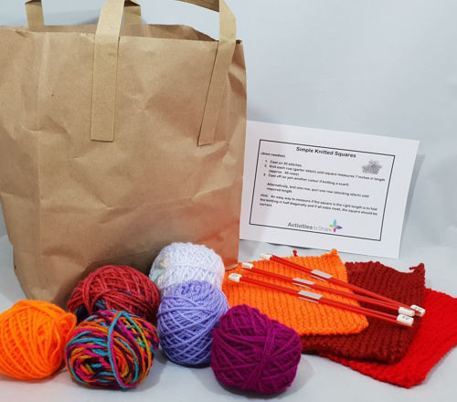 "Knit a Square, three pairs of plastic knitting needles, assorted balls of wool and instructions to make a knitted square, red knitting needles with three colourful knitted squares and assorted coloured balls of yarn, paper storage bag, size: needles 19cm long"">"