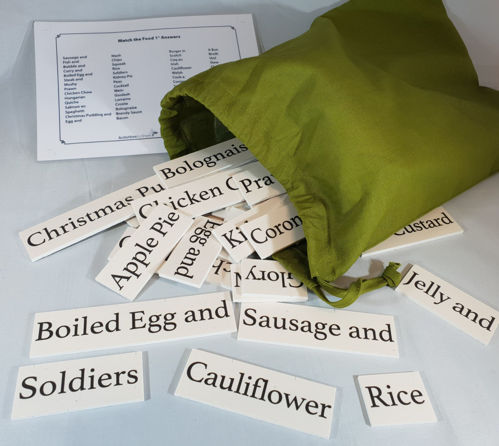 """<img src = """" Activities to Share Match the Foods Game, 60 wipe-clean plastic white tiles with large bold text showing part of a sentence, olive green cotton storage bag with laminated instruction sheet, tile size (h)3cm x various lengths"""">"""