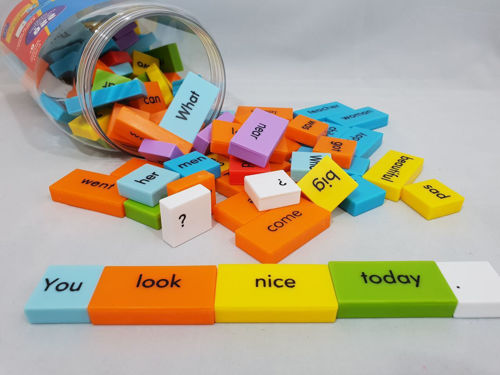 "<img src = "" Sentence Building Dominoes set, brightly coloured plastic chunky dominoes with nouns verbs etc in bold black lettering, clear plastic storage tub with screwtop lid, size approx 4.5cm x 2cm x 0.75cm"">"