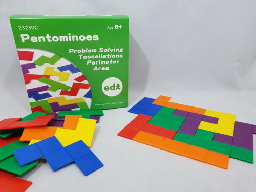 """<img src = """" Pentominoes game, colourful geometric plastic shapes to tessellate, 245 assorted plain coloured pieces in red green purple yellow blue orange, boxed with image of shapes on outer,  approx size 7.5cm x 12.5cm """">"""