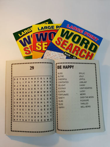 """<img src = """" Large Print Word Search Book, set of four assorted, open softback book with white pages and bold black lettering and three other closed books behind, A5 size each, colourful outer covers"""">"""