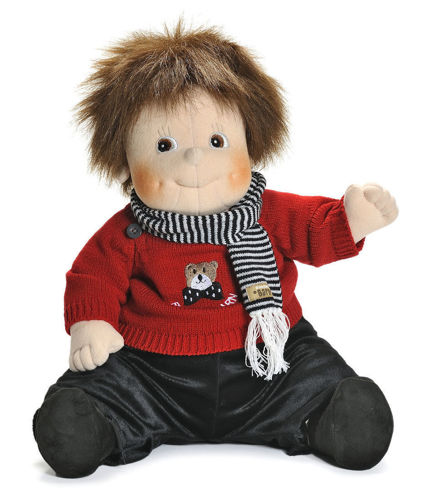 Empathy Doll - Teddy, nurture doll for dementia patients, image shows soft bodied doll in sitting position with brown hair and blue eyes, wearing a red knitted jumper and black velour trousers and striped scarf, washable removable clothes, size: (l) 50cm, weight: 1kg