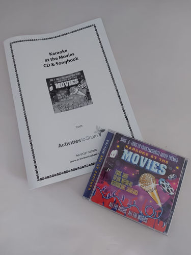 At the Movies CD and Songbook set, 16 well known movie tunes (instrumental) with large bold print song book, can be photocopied for groups, size: A4 softback songbook, CD 16 hit movie tracks
