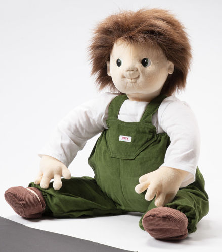 Joyk Empathy Doll - Marco, dementia therapy doll, image shows soft fabric doll with mid-length brown hair and eyes, dressed in white long-sleeved top with green corduroy dunSize: (l) 65cm. Material is man-made - hand wash at 40ºC.garees,