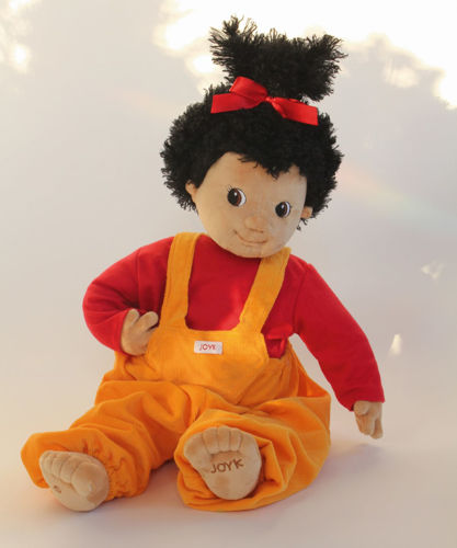 Joyk Empathy Doll, dementia therapy aid, soft fabric doll with mid length black hair tied up with a red bow, removable yellow dungarees and red top, hand wash 30 oC, size: (l) 47cm