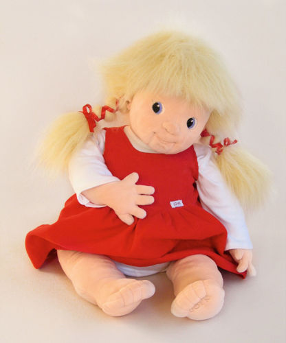 Joyk Empathy Doll - Nelly, dementia therapy doll, soft fabric doll with shaped facial nose and mouth, weighted bottom, blonde long hair tied into bunches with red ribbon, removable red dress with white top, hand wash 40 oC, Size: (l) 65cm