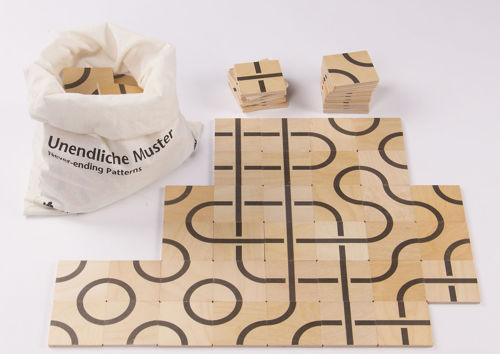 Never Ending Pattern Game, quality wooden matching activity, 104 wood tiles in semi circle or cross design, instructions and linen storage bag, Size: Tiles: approx: (l) 6cm x (w) 6cm.