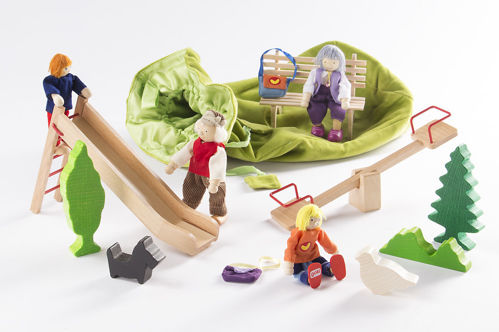 """Story Telling Bag - Park/Playground, wooden 12 piece set of pieces to aid storytelling and conversation, set includes:  1 seesaw, 1 slide, 1 bush, 1 fir tree, 1 poplar, 1 pigeon, 1 bench and 1 dog made of wood; 4 flexible dolls: grandma, grandpa, 2 children, including story text: """"Playground"""". Includes velvet storage bag. Dimensions: 30 x 35 cm, base Ø 18 cm."""