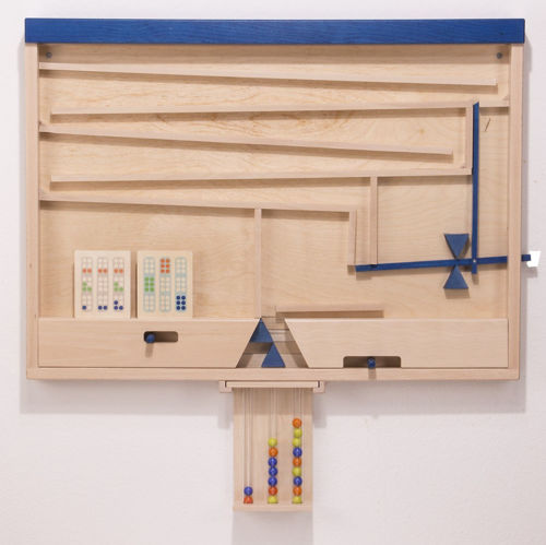 Marble Factory, cognitive game for older people, wall mounted, beech wood construction, set includes: 1 x wall game with removable tubes  12 x wooden task cards  18 x coloured marbles  Instructions  Wall fixings  Size: (l) 80cm x (w) 58cm x (d) 6cm. Tubes (l) 21cm, marbles (dia) 1.6cm