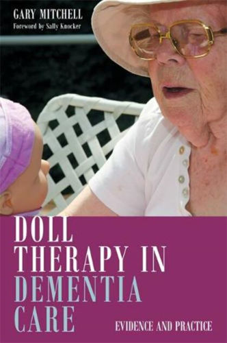 Doll Therapy in Dementia Care, author Gary Mitchell, care home resource, softback book cover depicting elderly lady holding doll, 136 pages, size: (l) 22.9cm x (w) 16.8cm.