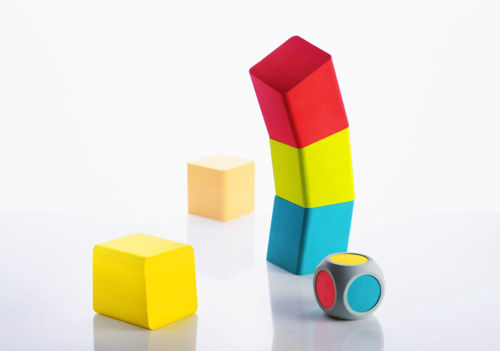 Large Foam Wonky Tower, colour coordinated game for care home residents, easy grip foam pieces in red yellow blue green and orange, wooden dice with same colours, Set contains:  20 x building blocks with varying slopes 1 x playing dice storage bag Size: Playing pieces: (l) 10cm x (w) 10cm x (d) 10cm. Dice: (l) 8cm x (w) 8cm x (d) 8cm.