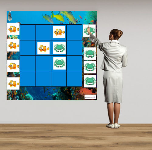 Magnetic Wall Game - Sealife, peel and stick to the wall fun game for all abilities, blue background with an underwater image border, orange fish and green crab tiles with white background, Set includes: 1 x peel and stick backing mat with 6 x crabs and 6 x fish.  Size: (l) 120cm x (w) 120cm