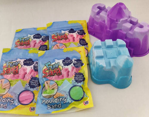 Moulding Sand Set, image shows 1 each sand mould purple castle with turret and blue small castle, 4 x assorted bags coloured moulding sand