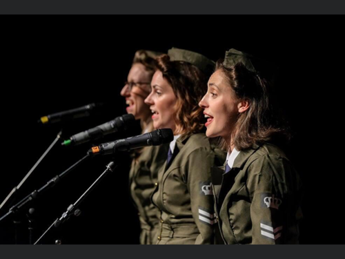 J Birds Musical Concert - live musical singalong concert to download for care home residents, image shows 3 wartime forces women dressed in khaki forces dress singing into microphones