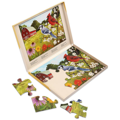 13 Large Piece Puzzle - Summer Birds, oversized pieces for easy grip, image shows part assembled puzzle with storage box, image is of colourful birds in a field with a house in the background, box shows completed image on lid, Storage box shows the finished picture to follow.  Size: Box: (w) 31cm x (h) 22cm x (d) 2cm.