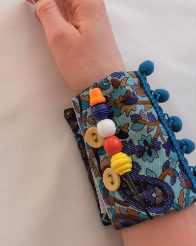 Fidget Arm Band - Floral, tactile arm band for dementia, recycled floral scarf with various attachments for restless hands, Arm Band features: textured fabrics buttons clip buckle theading beads bobble trim velcro fastening Hand wash or machine on gently cycle. Size: (24cm x 12cm).