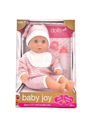 Baby Doll Joy, soft-bodied doll with bean-filled bottom and vinyl head, arms and feet. Eyes close when laid down. Removeable romper suit and hat and comes with dummy and bottle. Size: 38cm. Boxed.