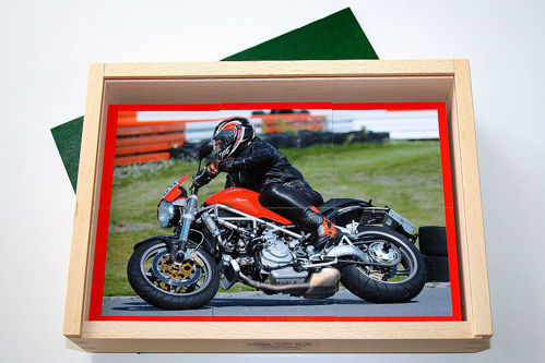 8 Large Piece Puzzle - Biker, motorbike themed set of 8 puzzles, each has 6 chunky pieces for older hands, image shows man on racing bike with red engine, size: 23.5cm x 17cm x 5cm.