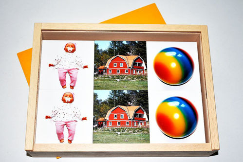 Memo Classic set, 2 each of 18 photographic image cards to use for games, inspiring conversation and reminiscence. Image shows colourful image of balls, country house and baby doll. Size: 23cm x 17cm x 5cm