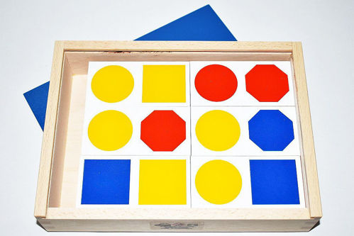 Shape Colour Dominoes for all abilities, large chunky pieces, image shows open box with vibrant domino pieces in red, blue and yellow, size: 23.5cm x 17cm x 5cm